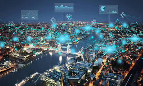 Photo of a cityscape at night shows how interactive digital twin cities can be used by urban planners, policymakers, and asset owners.